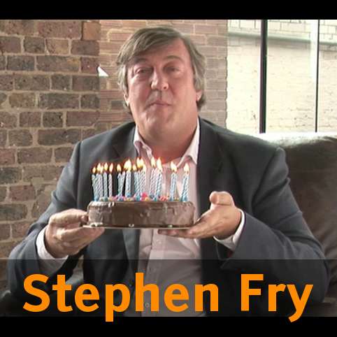 [Photo of Fry presenting GNU's birthday cake, with text: 'Stephen Fry']